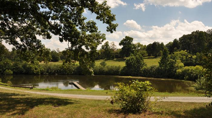 From the broad front porch, you have a view of the pond and beautiful hills of Rural Ridge Orchard.