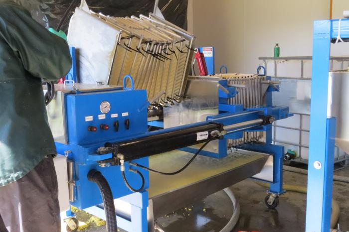 Once the pommace is squeezed dry, it's emptied from the bags and the process starts again.